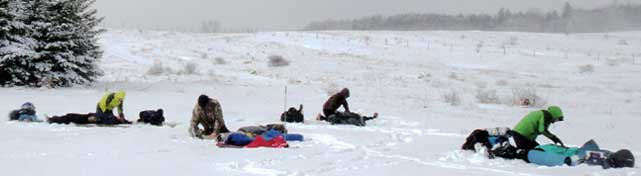 Students assess injuries and care for patients in the snow