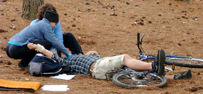 Photo: students caring for a bicycle crash victim during dtWFA class