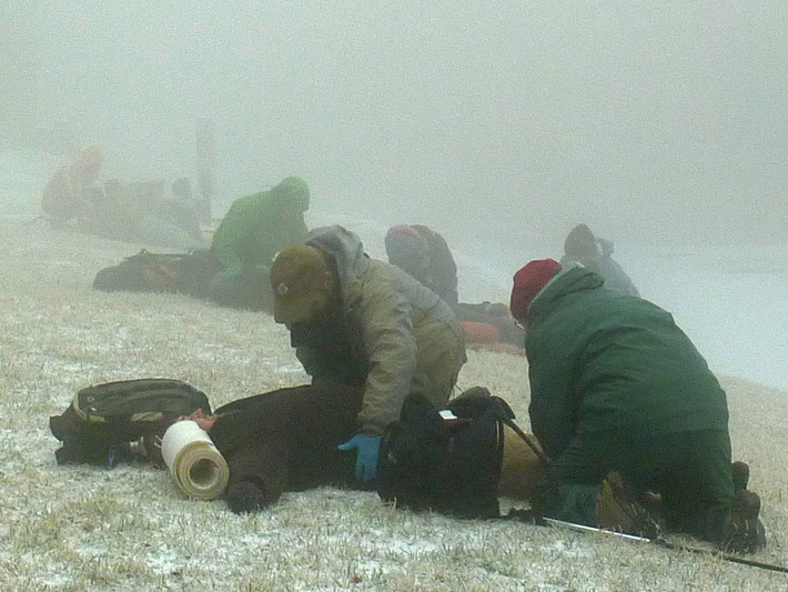 Caring for someone in snowy, foggy mountain-top conditions