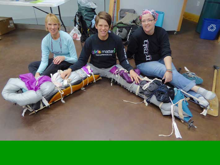 Caregivers and patient smile after splinting two fractured legs